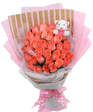 33 pink roses with a doll